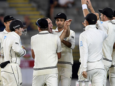 New Zealand players celebrate the dismissal of England's Craig Overton on the final day's play during the first cricket test in Auckland, New Zealand, Monday, March 26, 2018. (AP Photo/Ross Setford)