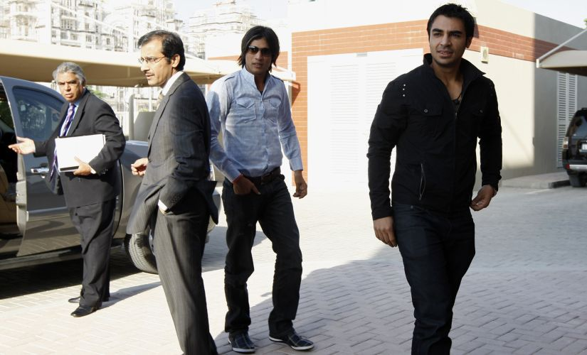 Pakistan cricket players Salman Butt (R) and Mohammad Amir (C) arrive for the second day of their hearing at the ICC headquarters in Dubai 31 October, 2010. Reuters