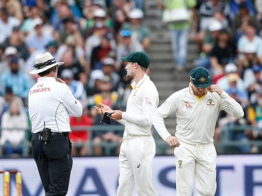 Australian fielder Cameron Bancroft (R) is questioned by umpires during the third Test. AFP