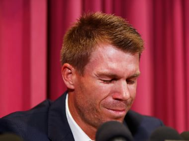 David Warner cries as he talks to the media after being sent home from South Africa following a ball tampering scandal. AP