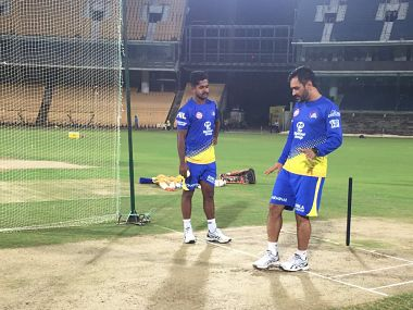 Chennai Super Kings skipper MS Dhoni interacts with a player during practice. Image courtesy: Twitter @RussCSK