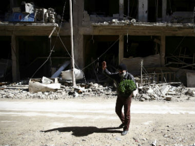 Fresh air raids pound Syrias rebelheld Eastern Ghouta 70 civilians killed in 24 hours