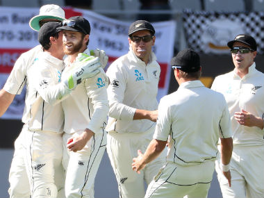 New Zealand players celebrate England's wicket on the opening day of the first Test at Auckland. AFP