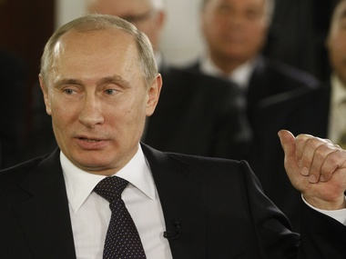 Following reelection Vladimir Putin vows to cut defence spending says Russia wont allow arms race
