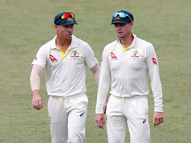 Cricket - South Africa vs Australia - First Test Match - Kingsmead Stadium, Durban, South Africa - March 5, 2018. Australia's David Warner and Steve Smith leave the pitch after beating South Africa. REUTERS/Rogan Ward - RC143BC9ABF0