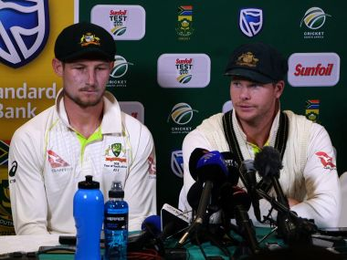 Australia's captain Steve Smith (R), flankled by teammate Cameron Bancroft, speak during a press conference. AFP
