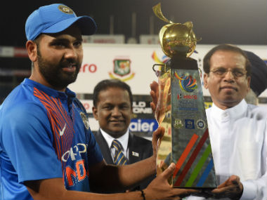 Indian captain Rohit Sharma (L) receives the Nidahas Trophy after the thrilling win over Bangladesh in Colombo. AFP