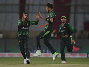 Pakistani cricketer Mohammad Amir (C) celebrates with teammates after taking the wickets of West Indies batsman Andre Fletcher during the first T20 cricket match between Pakistan and West Indies at The National Stadium in Karachi on April 1, 2018. Pakistan compiled a solid 203-5 in the first Twenty20 international against the West Indies in Karachi, the first international match in the city for nine years. / AFP PHOTO / ASIF HASSAN