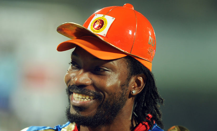 RESTRICTED TO EDITORIAL USE. MOBILE USE WITHIN NEWS PACKAGE Royal Challengers Bangalore batsman Chris Gayle looks on with his highest run scorer Orange Cap after the IPL Twenty20 cricket final match between Chennai Super Kings and Royal Challengers Bangalore at The M.A.Chidambaram Stadium in Chennai on May 29, 2011. Chennai Super Kings won the match by 58runs to retain the title. AFP PHOTO/Dibyangshu SARKAR / AFP PHOTO / DIBYANGSHU SARKAR