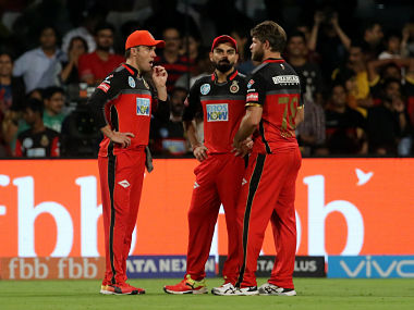 Corey Anderson (R), Virat Kohli and AB de Villiers in conference during RCB vs CSK. Sportzpics
