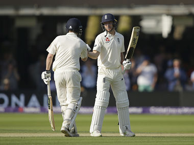 England's Jos Butler, right, shakes hands with playing partner England's England's Don Bess as he celebrates reaching 50 not out during the third day of play of the first test cricket match between England and Pakistan at Lord's cricket ground in London, Saturday, May 26, 2018. (AP Photo/Alastair Grant)