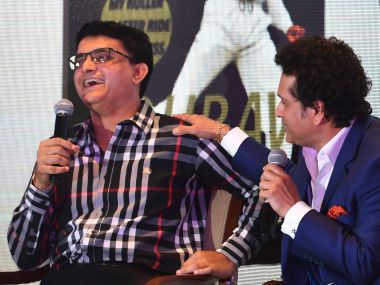 Sourav Ganguly and Sachin Tendulkar share a light moment during the book launch of Ganguly's book. AFP