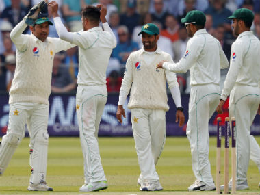 Pakistan captain and wicket-keeper Sarfraz Khan celebrate an England wicket with his teammates. AFP