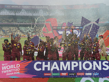 West Indies cricketers celebrate after winning the women's World T20 cricket tournament final match between Australia and West Indies at The Eden Gardens Cricket Stadium in Kolkata on April 3, 2016. / AFP PHOTO / Indranil MUKHERJEE