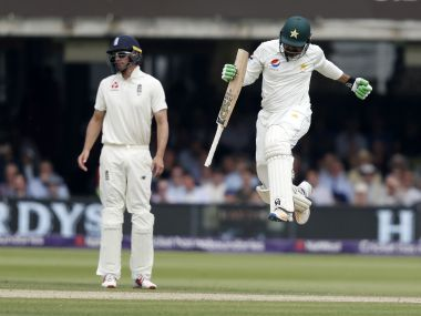 Pakistan's Haris Sohail (right) jumps in the air after hitting the winning runs as England's Alastair Cook looks on during the first Test. AFP