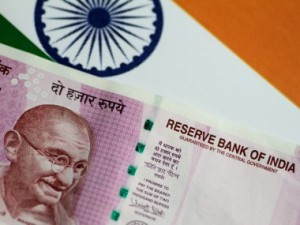 Rupee dives 29 paise to close at 7035 against US dollar even as crude oil prices ease