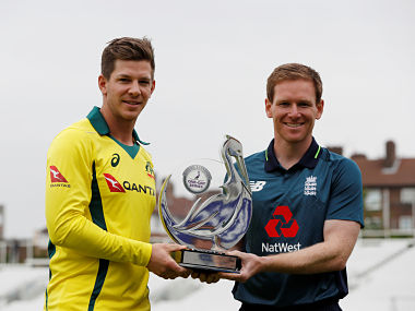 Australia's Tim Paine and England's Eoin Morgan pose with the trophy. Reuters