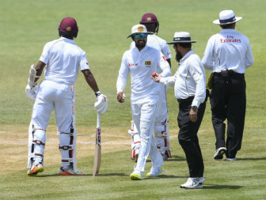 Umpire Aleem Dar checks the ball on Day 3 of the second Test between West Indies and Sri Lanka. AFP