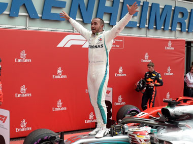 German Grand Prix Lewis Hamilton seals miraculous victory after Sebastian Vettel crashes out takes Championship lead