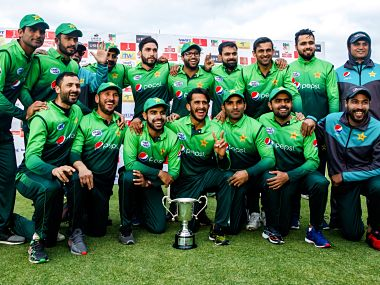 Pakistan's pose with the trophy during the price ceremony after winning the fifth One-Day International (ODI) series final cricket match against Zimbabwe at the Queens Sports Club in Bulawayo, on, July 22, 2018. / AFP PHOTO / Jekesai NJIKIZANA