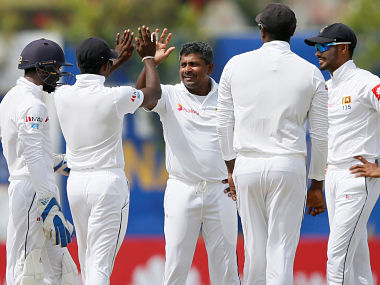 Cricket - Sri Lanka v South Africa - First Test Match - Galle, Sri Lanka - July 13, 2018 - Sri Lanka's Rangana Herath (C) celebrates with his teammates after taking the wicket of South Africa's Dean Elgar (not pictured). REUTERS/Dinuka Liyanawatte - RC1B87008090