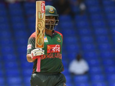 Tamim Iqbal of Bangladesh celebrates his half century during the 3rd ODI against West Indies. AFP