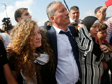 Palestinian teen Ahed Tamimi released from prison after eight months jailed for slapping two Israeli soldiers