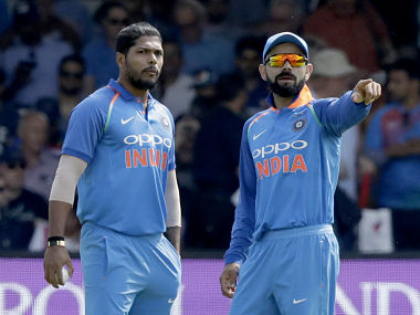India captain Virat Kohli gives instructions to Umesh Yadav during the second ODI. AP