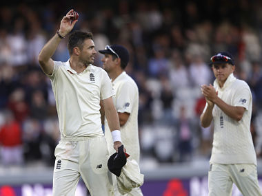 James Anderson holds up the ball to applause as he leaves the pitch after India are bowled out for 107 during the second day of the second test match between England and India at Lord's cricket ground in London, Friday, Aug. 10, 2018. (AP Photo/Kirsty Wigglesworth)