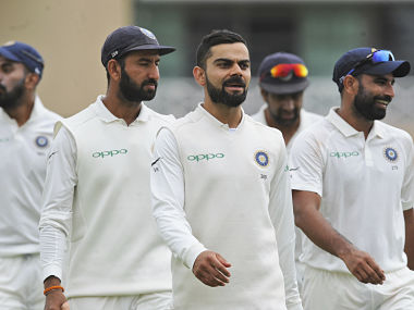 Indian cricket captain Virat Kohli leads his teammates off the field as the play breaks for lunch during the fourth day of the third cricket test match between England and India at Trent Bridge in Nottingham, England, Tuesday, Aug. 21, 2018. (AP Photo/Rui Vieira)