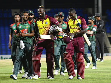 Shakib Al Hasan of Bangladesh Andre Russell and Rovman Powell of Windies smile at the end of the 1st T20i match at Warner Park. AFP