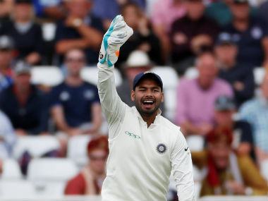 Rishabh Pant celebrates after collecting his first catch in Test cricket, that of Alastair Cook's. Reuters