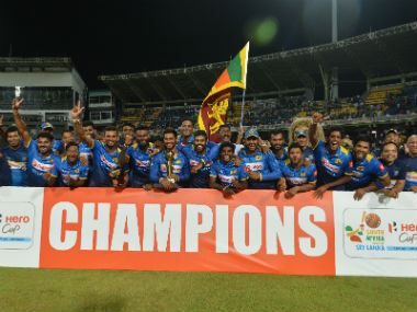 Sri Lanka's cricket team poses for photographers after winning the international Twenty20 match against South Africa at the R.Peremadasa Stadium in Colombo. AFP
