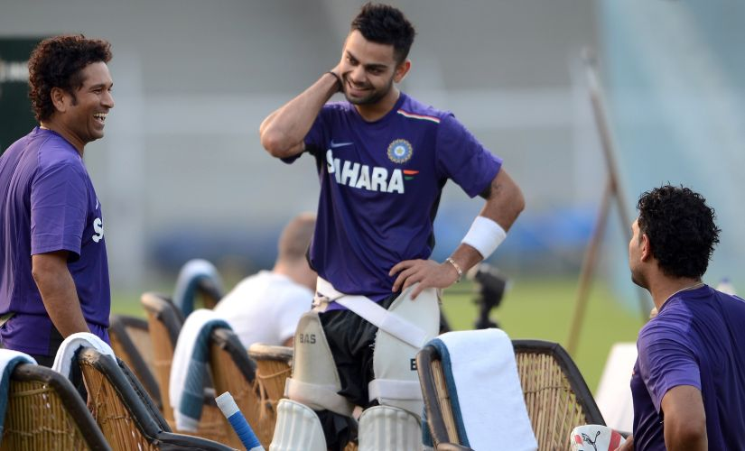 Learning from the master: Virat's rapport with his seniors is one of mutual respect and admiration. AFP