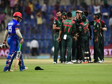 Bangladesh team celebrates the victory during the one day international (ODI) Asia Cup cricket match between Afghanistan and Bangladesh at The Sheikh Zayed Stadium in Abu Dhabi on September 23, 2018. / AFP PHOTO / GIUSEPPE CACACE