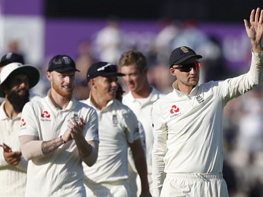 England's Joe Root, right,leads his players from the pitch after England defeated India on the fourth day of the 4th cricket test match between England and India at the Ageas Bowl in Southampton, England, Sunday, Sept. 2, 2018. England and India are playing a 5 test series. (AP Photo/Alastair Grant)