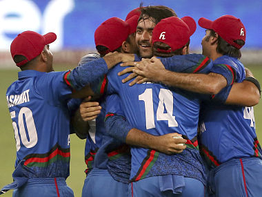 Afghanistan players congratulate teammate Rashid Khan after he dismissed India's last wicket of Ravindra Jadeja during the one day international cricket match of Asia Cup in Dubai. AP