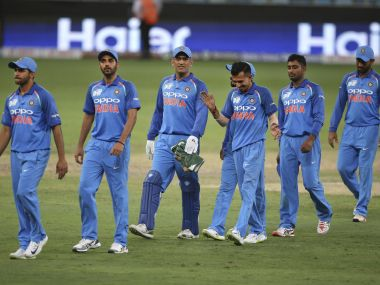 Indian players leave the ground after their win over Hong Kong. AP photo
