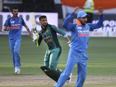 Pakistan's Shoaib Malik, center, after India's Bhuvneshwar Kumar dropped his catch during the one day international cricket match of Asia Cup between India and Pakistan in Dubai, United Arab Emirates, Wednesday, Sept. 19, 2018. (AP Photo/Aijaz Rahi)