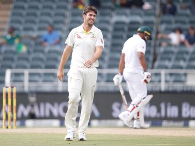 Australia's Mitchell Marsh (left) reacts during the fourth Test against South Africa. AFP