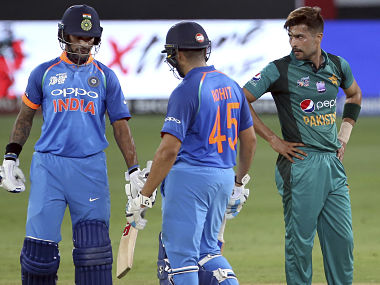 Pakistan's Mohammad Amir reacts after India's Shikhar Dhawan hit a boundary on his delivery during the one day international cricket match of Asia Cup in Dubai. AP