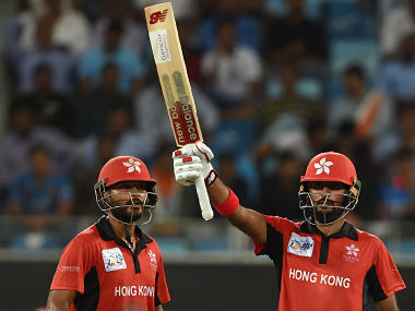 Nizakat Khan (R) celebrates after scoring his half-century with Anshuman Rath, against India in the Asia Cup. AFP