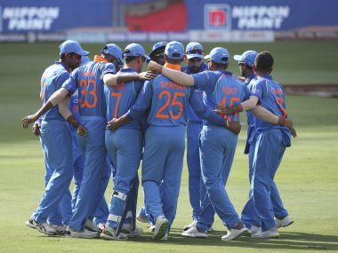 The Indian team stands in a huddle before the start of the match against Pakistan. AP Photo