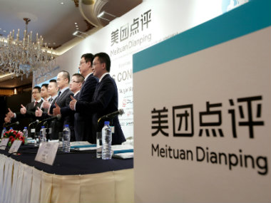 Tencentbacked Meituan raises 42 bn in worlds biggest internetfocussed IPO priced near range top Sources