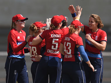 England cricketer Natalie Sciver (R) is congratulated by teammates after taking the wicket of Australian cricketer Alyssa Healy during the second cricket match of the women's Twenty 20 (T20) Tri-Series between Australia and England at Brabourne Stadium in Mumbai on March 23, 2018. (Photo by INDRANIL MUKHERJEE / AFP) / ----IMAGE RESTRICTED TO EDITORIAL USE - STRICTLY NO COMMERCIAL USE----- / GETTYOUT