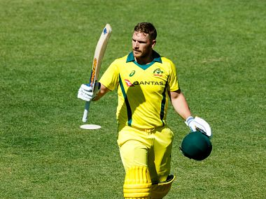 Australia's captain Aaron Finch waves to the crowd as he walks off the pitch after loosing his wicket during the third match played between Australia and hosts Zimbabwe as part of a T20 tri-series which includes Pakistan at Harare Sports Club, on July 3 2018. (Photo by Jekesai NJIKIZANA / AFP)