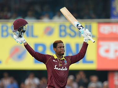 West Indies batsman Shimron Hetmyer raises his bat and helmet after he completed his century (100 runs) during the first one day international (ODI) cricket match between India and West Indies at Barsapara Cricket Stadium in Guwahati on October 21, 2018. (Photo by SAJJAD HUSSAIN / AFP) / ----IMAGE RESTRICTED TO EDITORIAL USE - STRICTLY NO COMMERCIAL USE----- / GETTYOUT