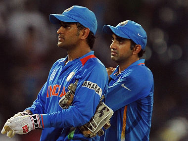 Indian cricket captain Mahendra Singh Dhoni (L) and Gautam Gambhir (R) react after they were defeated during the ICC Twenty20 Cricket World Cup's Super Eight match between India and South Africa at the R. Premadasa International Cricket Stadium in Colombo on October 2, 2012.AFP PHOTO/ LAKRUWAN WANNIARACHCHI (Photo by LAKRUWAN WANNIARACHCHI / AFP)
