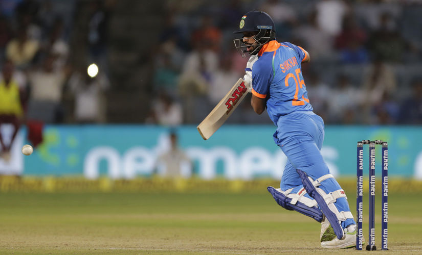 India's Shikhar Dhawan bats during the third one-day international cricket match between India and West Indies in Pune, India, Saturday, Oct. 27, 2018. (AP Photo/Rajanish Kakade)