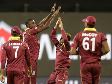 West Indies' captain Jason Holder, second left, celebrates with teammates the dismissal of India's Mahendra Singh Dhoni during the third one-day international cricket match between India and West Indies in Pune, India, Saturday, Oct. 27, 2018. (AP Photo/Rajanish Kakade)